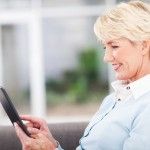 woman over 50 using tablet computer