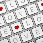 computer keyboard with hearts and LOVE letters